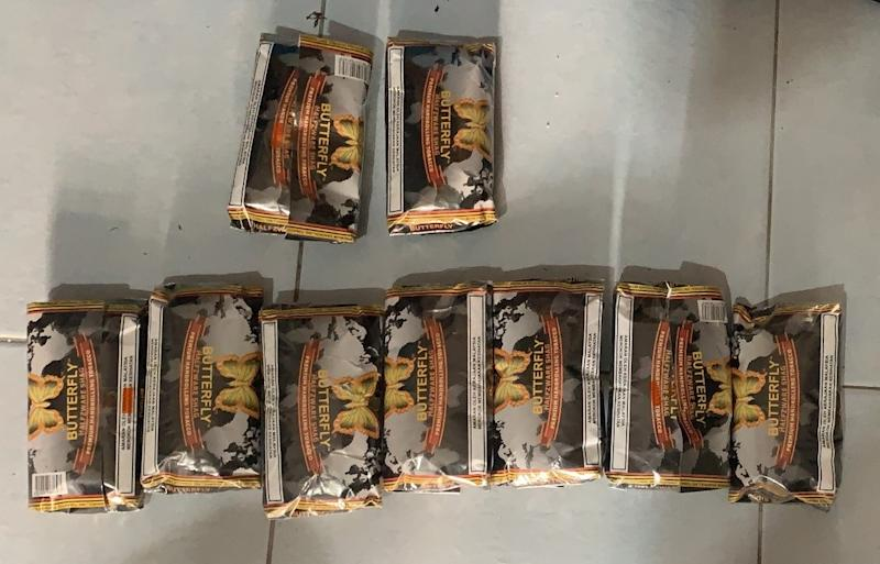 "About 1,138g of the ""mushroom"" drug was found in packets of the ""Butterfly"" brand tobacco product at one of suspect's residences. (PHOTO: CNB)"