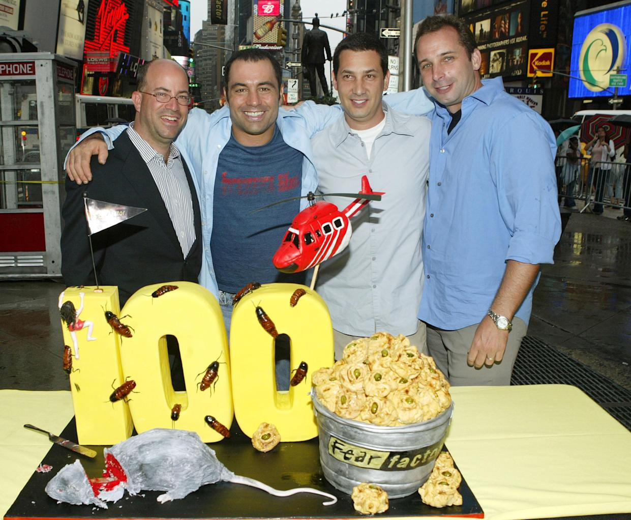 NEW YORK - JULY 12:  (L-R) NBC President Jeff Zucker, Fear Factor host Joe Rogan and executive producers Matt Kunitz and David Hurwitz attend the show's 100th episode celebration in Times Square July 12, 2004 in New York City.  (Photo by Peter Kramer/Getty Images)