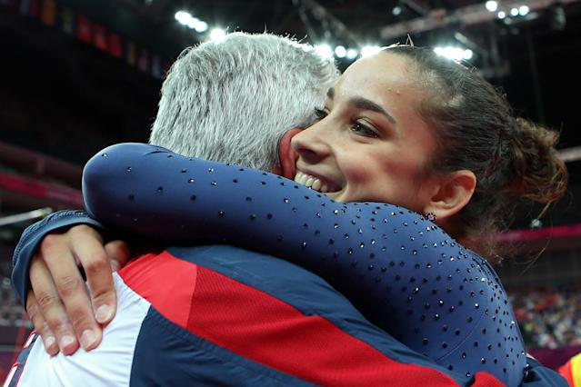 Alexandra Raisman of the United States hugs coach Mihai Brestyan after winning the gold medal for the Artistic Gymnastics Women's Floor Exercise final on Day 11 of the London 2012 Olympic Games at North Greenwich Arena on August 7, 2012 in London, England. (Photo by Ronald Martinez/Getty Images)