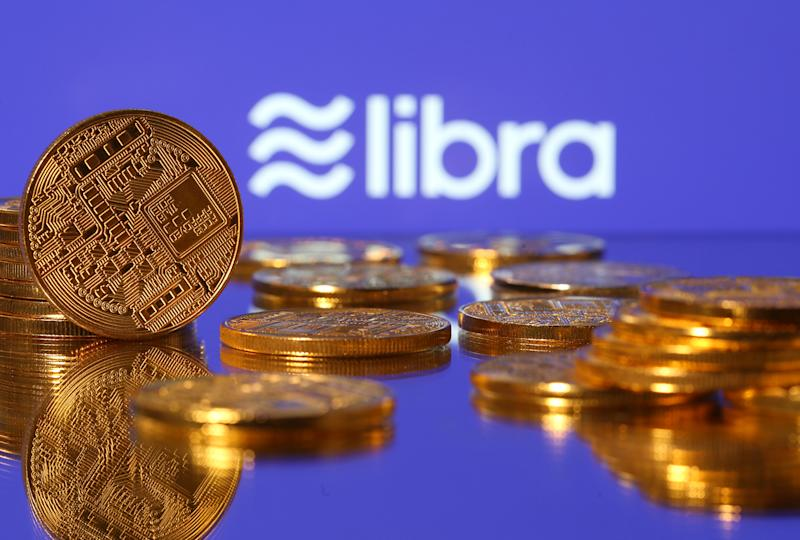 Representations of virtual currency are displayed in front of the Libra logo in this illustration picture, June 21, 2019. REUTERS/Dado Ruvic/Illustration
