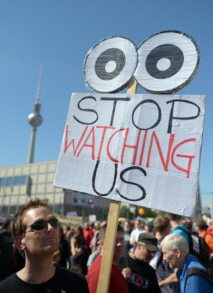 Activists protest with posters during a demonstration in Berlin, Saturday, Sept. 7, 2013. German news weekly Der Spiegel reports Sunday Sept. 8, 2013 that the U.S. National Security Agency can access users' data on all major smartphones. The magazine cites internal documents from the NSA and its British counterpart GCHQ in which the agencies describe setting up dedicated teams to crack protective measures on iPhones, BlackBerry and Android devices. This data includes contacts, call lists, SMS traffic, notes and location data. (AP Photo/dpa,Rainer Jensen)