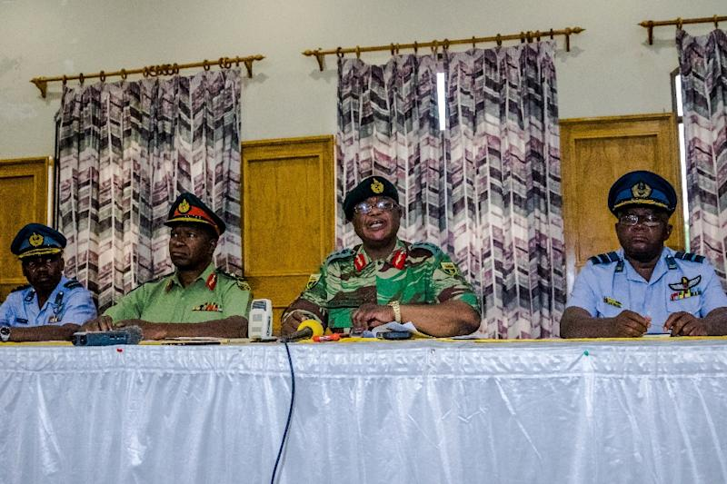 Army chief Constantino Chiwenga (centre, right) on Monday warned of military intervention if the purges continued (AFP Photo/Jekesai NJIKIZANA)