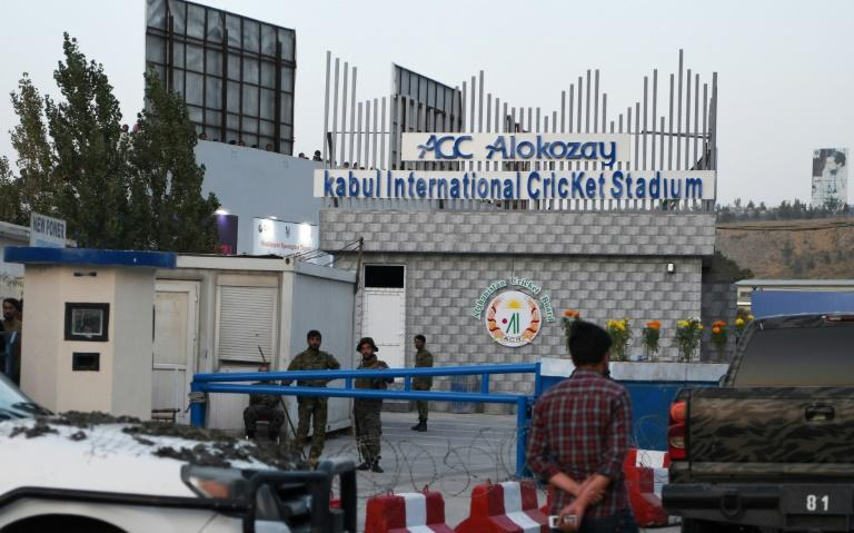 "Security cordons at the Kabul International Cricket ground after a suicide bomb attack on September 13. Former England captain Adam Hollioake was inside the ground and felt the blast but says he would return to Kabul ""in a heartbeat"""