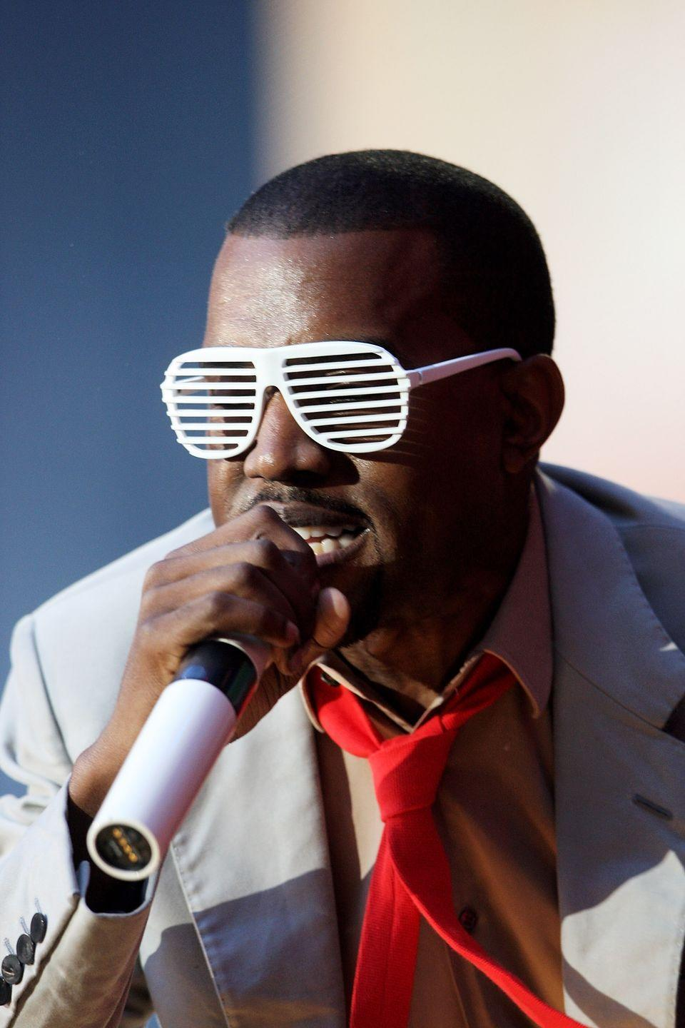 <p>Kayne West helped make shutter shades trendy after wearing them in concert and at award shows. The aviator-type glasses soon became part of his go-to look in the mid-2000s. </p>