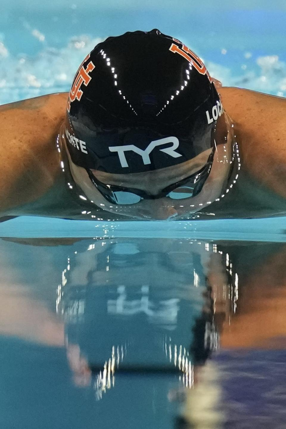 Ryan Lochte participates in the men's 200 Individual Medley during wave 2 of the U.S. Olympic Swim Trials on Thursday, June 17, 2021, in Omaha, Neb. (AP Photo/Charlie Neibergall)