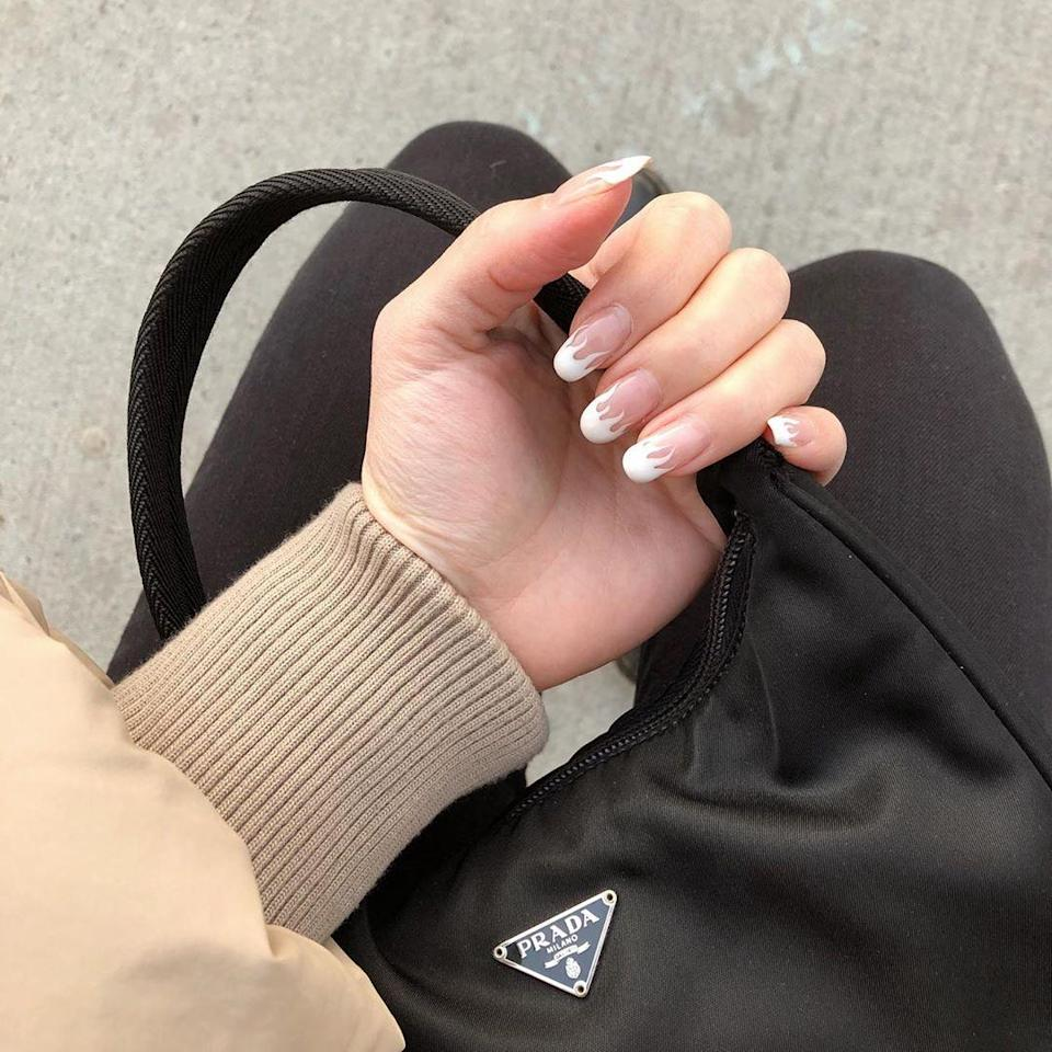 There are a lot of trends here—French mani, cool flames, and square tips—but a neutral color palette keeps it from being overwhelming and makes nails look super long.
