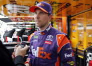 Denny Hamlin is interviewed after practice for the NASCAR Cup Series auto race at the Homestead-Miami Speedway, Saturday, Nov. 17, 2018, in Homestead, Fla. Hamlin won the pole position. (AP Photo/Terry Renna)
