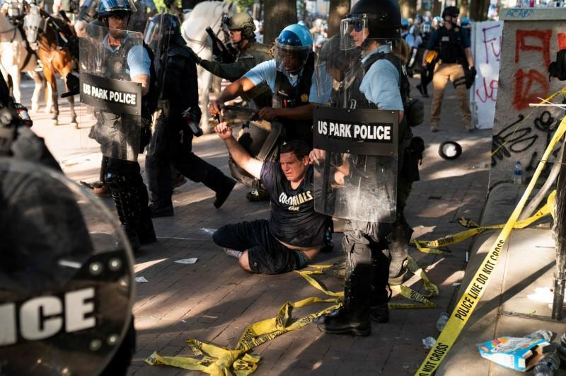 Riot police clear Lafayette Park for a photo opportunity by President Donald Trump in Washington