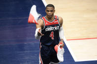 Washington Wizards guard Russell Westbrook throws his shoe into the stands after the team's NBA basketball game against the Cleveland Cavaliers, Friday, May 14, 2021, in Washington.(AP Photo/Nick Wass)