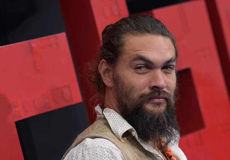 US actor Jason Momoa arrives for the premiere of