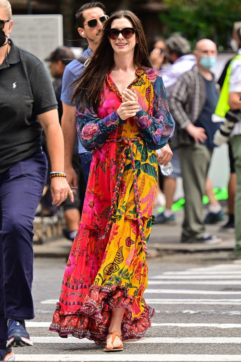 <p><strong>10 September</strong></p><p>Anne Hathaway was seen in New York embracing brights in a floaty dress and sandals.</p>