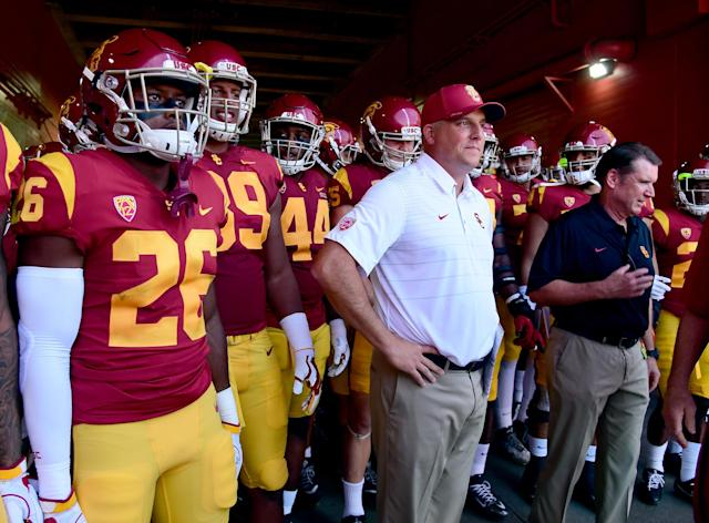 "USC coach Clay Helton named true freshman <a class=""link rapid-noclick-resp"" href=""/ncaaf/players/292978/"" data-ylk=""slk:JT Daniels"">JT Daniels</a> the Trojans' starting quarterback on Sunday night, one week before their season opener against UNLV. (Getty Images)"
