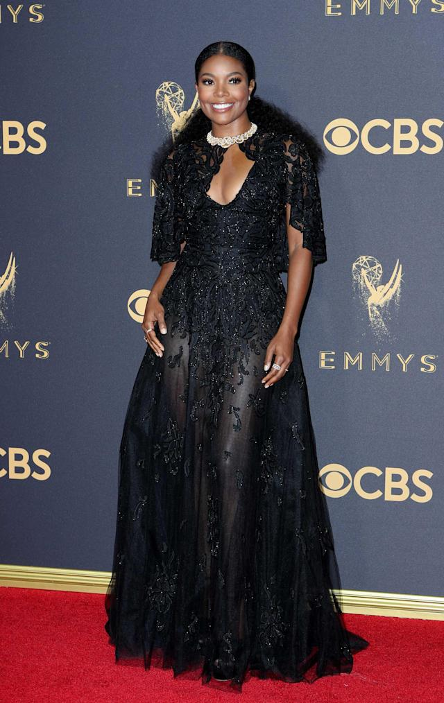 <p>The <em>Being Mary Jane</em> actress was one of the most elegantly dressed on the red carpet in a gown/cape combo from Zuhair Murad. (Photo: Reuters) </p>