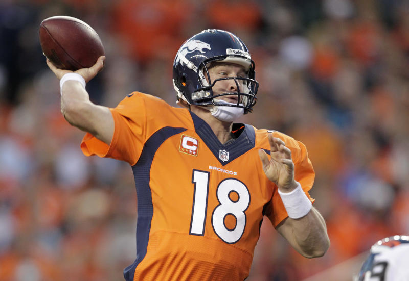 Denver Broncos quarterback Peyton Manning (18) throws a pass against the Oakland Raiders in the first quarter of an NFL football game, Monday, Sept. 23, 2013, in Denver. (AP Photo/Joe Mahoney)