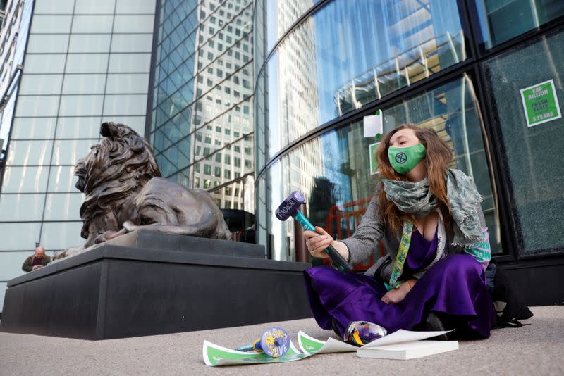 Extinction Rebellion activists protest at Canary Wharf in London
