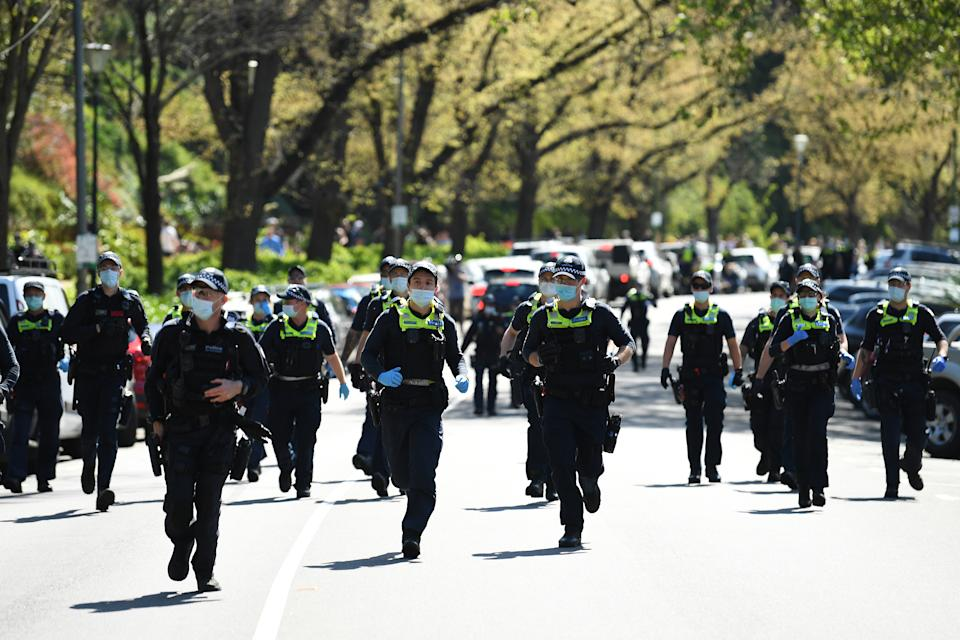 Victorian Police officers at an anti-mandatory vaccination protest in Melbourne, Saturday. Source: AAP