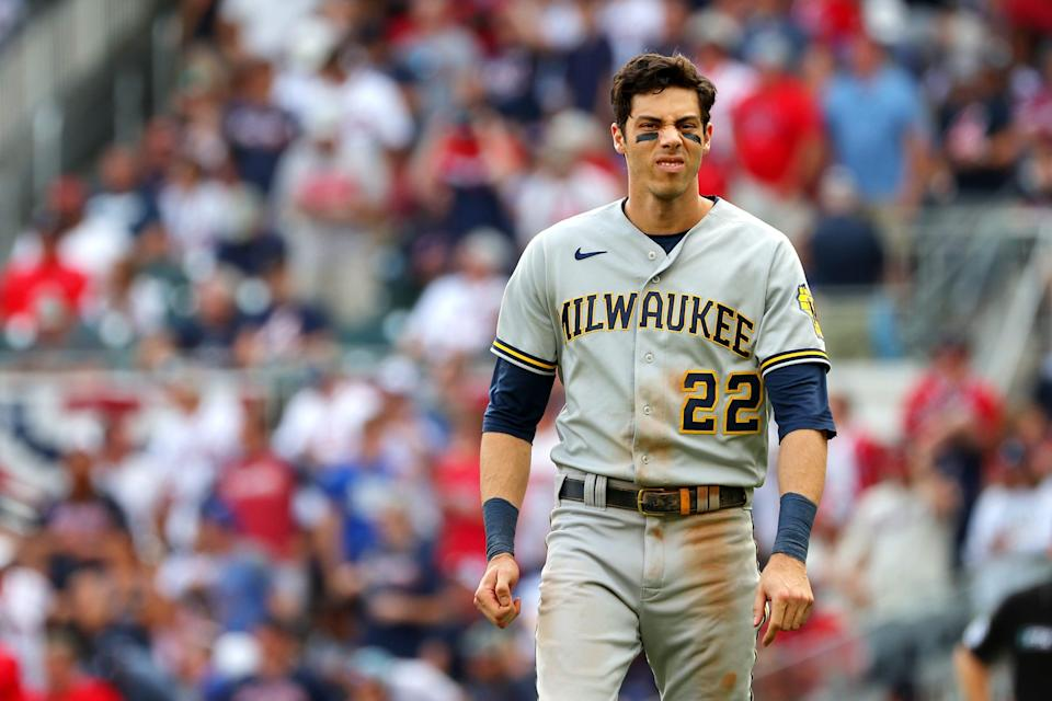 ATLANTA, GEORGIA - OCTOBER 11: Christian Yelich #22 of the Milwaukee Brewers reacts after being thrown out at first during the eighth inning against the Atlanta Braves in game 3 of the National League Division Series at Truist Park on October 11, 2021 in Atlanta, Georgia. (Photo by Kevin C. Cox/Getty Images)