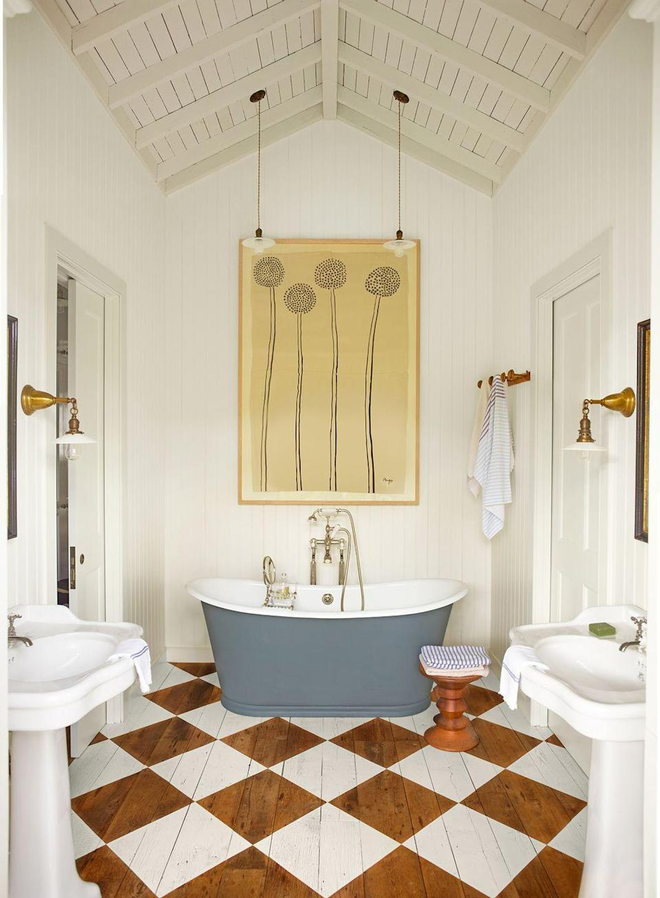 <p>Brown-and-white checkered flooring brings this bathroom to life. </p>