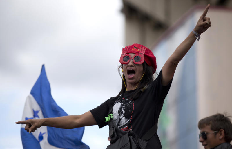 A supporter of the Free Party presidential candidate Xiomara Castro shouts slogans during a protest against election results in Tegucigalpa, Honduras, Monday, Nov. 25, 2013. The two top presidential candidates continued to claim victory Monday in a hotly contested presidential race, as Hondurans awaited final results. (AP Photo/Eduardo Verdugo)