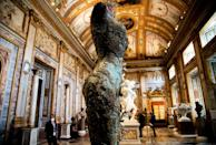 Hirst used traditional materials like bronze that almost blend in to the historic artworks around them