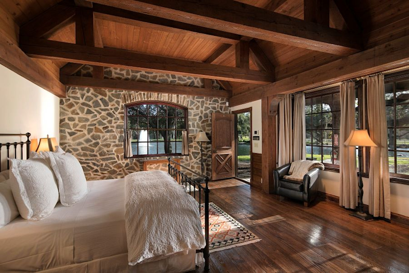 A bedroom at Neverland Ranch offers a waterfront view. (Photo: Compass)