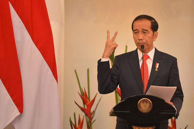 Indonesian President Joko Widodo delivers a speech at Foreign Ministry office in Jakarta