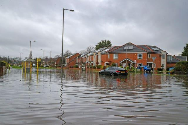 Flooded roads in West Derby, Liverpool (Peter Byrne/PA)