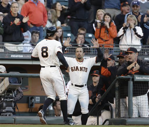 San Francisco Giants' Hunter Pence (8) is greeted at the dugout by left fielder Andres Torres, center, and manager Bruce Bochy, right, after hitting a home run off Oakland Athletics starting pitcher Tommy Milone during the second inning of a baseball game Wednesday, May 29, 2013, in San Francisco. (AP Photo/Eric Risberg)