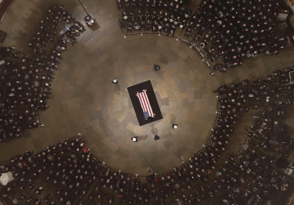 Palebearers carry the casket of Former President George H. W. Bush into the U.S. Capitol Rotunda Monday, Dec. 3, 2018, in Washington. (Photo: Morry Gash/Pool via AP)