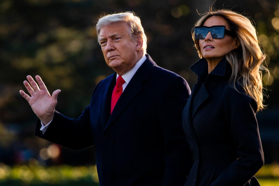 President Donald Trump and First Lady Melania Trump walk towards Marine One as they depart the White House en route to Mar-a-Lago, the President's private club, where they will spend Christmas and New Years Eve in Washington, DC on December 23, 2020. - President Donald Trump has thrown a long-awaited pandemic relief package into doubt days before millions of Americans will lose their benefits and face eviction from their homes. (Photo by Samuel Corum / AFP) (Photo by SAMUEL CORUM/AFP via Getty Images)