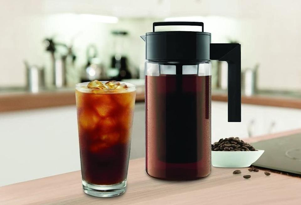 "It'll delight coffee snobs who feel like they've ~bean~ looking for the perfect cold brew maker forever.<br /><br /><strong>Promising review:</strong> ""If you LOVE iced coffee (I drink it year round regardless of the weather), then you NEED this cold brewer. I work for Starbucks, and I love their cold brew. I was skeptical to make it at home, but I love mine more than theirs. It's especially nice since Starbucks only brews one kind of beans for cold brew, but at home, you can brew your favorite kind. <strong>Absolutely love this, and it's worth more than it costs.</strong> A must-buy for yourself or a wonderful gift for the coffee lover in your life!"" — <a href=""https://amzn.to/3gg9gPi"" target=""_blank"" rel=""nofollow noopener noreferrer"" data-skimlinks-tracking=""5878601"" data-vars-affiliate=""Amazon"" data-vars-href=""https://www.amazon.com/gp/profile/amzn1.account.AF4FUU2REFLDWGRQMTW64RU4YVBQ?tag=bfmal-20&ascsubtag=5878601%2C30%2C32%2Cmobile_web%2C0%2C0%2C16416126"" data-vars-keywords=""cleaning,fast fashion"" data-vars-link-id=""16416126"" data-vars-price="""" data-vars-product-id=""15961818"" data-vars-retailers=""Amazon"">j.blaine</a><br /><br /><strong>Get it from Amazon for <a href=""https://amzn.to/3srmKtQ"" target=""_blank"" rel=""noopener noreferrer"">$19.99</a> (available in three colors).</strong>"