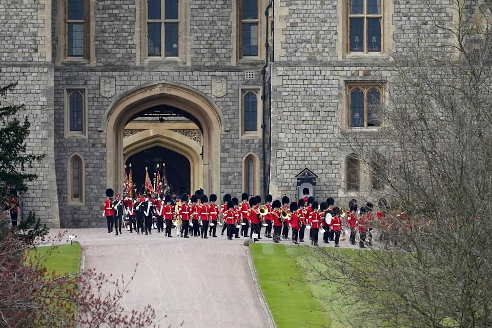 A military band leaves Windsor Castle after taking part in a rehearsal ahead of Prince Philip, Duke of Edinburgh's funeral on April 15, 2021 in Windsor, England Prince Philip, Duke of Edinburgh's ceremonial royal funeral will take place on April 17th at Windsor Castle.  (Photo by Christopher Furlong/Getty Images)