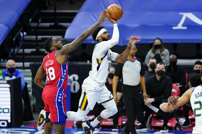 Utah Jazz's Mike Conley, right, tries to get a shot past Philadelphia 76ers' Shake Milton during overtime in an NBA basketball game, Wednesday, March 3, 2021, in Philadelphia. (AP Photo/Matt Slocum)