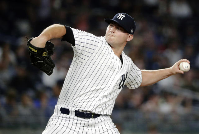 FILE - In this July 26, 2018, file photo, New York Yankees' Zach Britton delivers a pitch during the eighth inning of a baseball game against the Kansas City Royals, in New York. Zack Britton will be a different pitcher for the New York Yankees this year _ at least in name. Known throughout his baseball career as Zach, the 31-year-old reliever said Thursday, Feb. 7, 2019, going forward his name should be spelled Zack.(AP Photo/Frank Franklin II, File)