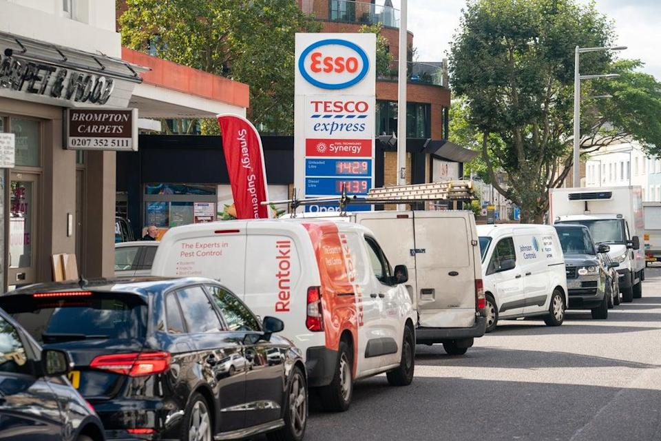 Vehicles queue for fuel at a petrol station in west London (Dominic Lipinski/PA) (PA Wire)