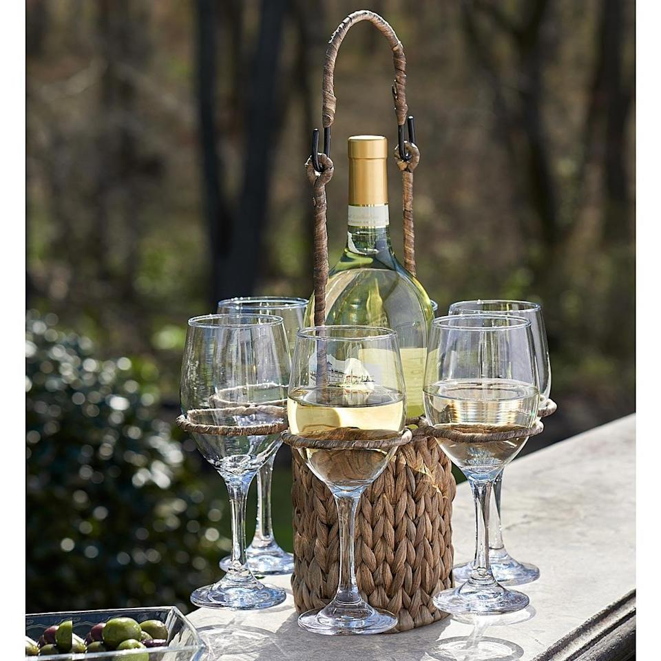 <p>This <span>Woven Wine Tote with Glasses</span> ($50) is so chic.</p>