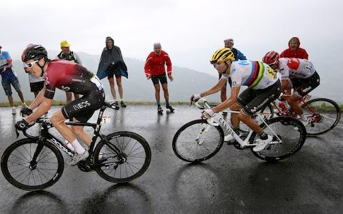 <span>Geraint Thomas (left) responds, taking with him Alejandro Valverde (centre) and Richie Porte</span> <span>Credit: Getty Images </span>