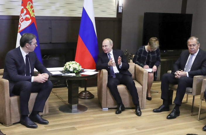 Russian President Vladimir Putin, center, speaks to Serbian President Aleksandar Vucic, left, as Russian Foreign Minister Sergey Lavrov, right, attends the talks in the Bocharov Ruchei residence in the Black Sea resort of in Sochi, Russia, Wednesday, Dec. 4, 2019. Putin and Vucic talked about Russian natural gas supplies, military cooperation and other issues during their meeting. (Mikhail Klimentyev, Sputnik, Kremlin Pool Photo via AP)