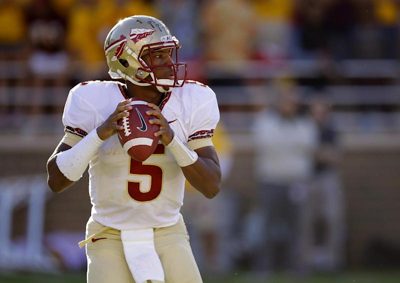 Florida State quarterback Jameis Winston (5) looks down field for an open receiver during the first half of an NCAA college football game against the Boston College in Boston, Mass., Saturday, Sept. 28, 2013