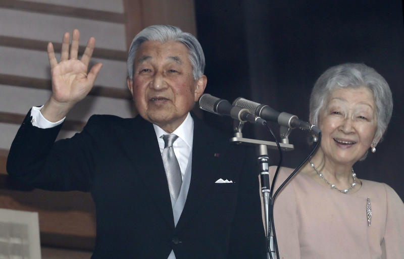 Japan's Emperor Akihito, left, accompanied by his wife Empress Michiko, right, waves to well-wishers as they appear on the balcony of the Imperial Palace to mark the emperor's 85th birthday in Tokyo Sunday, Dec. 23, 2018. (AP Photo/Eugene Hoshiko)