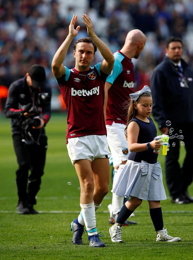 "Soccer Football - Premier League - West Ham United vs Everton - London Stadium, London, Britain - May 13, 2018 West Ham United's Mark Noble during a lap of honour after the match REUTERS/Eddie Keogh EDITORIAL USE ONLY. No use with unauthorized audio, video, data, fixture lists, club/league logos or ""live"" services. Online in-match use limited to 75 images, no video emulation. No use in betting, games or single club/league/player publications. Please contact your account representative for further details."