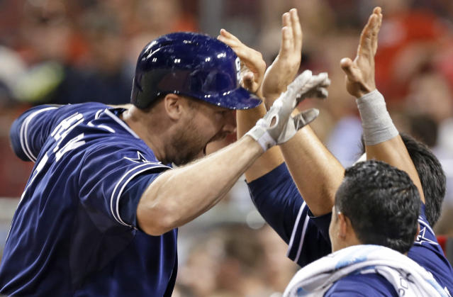 San Diego Padres' Chase Headley, left, is congratulated after hitting a solo home run off Cincinnati Reds relief pitcher Aroldis Chapman in the ninth inning of a baseball game, Tuesday, May 13, 2014, in Cincinnati. San Diego won 2-1. (AP Photo)