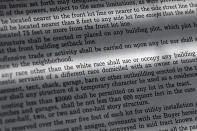 """In this Saturday, July 17, 2021, photo, a copy of a covenant for property now owned by Fred Ware is seen in Manchester, Conn. Fred and Dave Ware recently found a whites-only covenant on his property dating back to 1942 when researching the title chain. The covenant described as letter """"F"""" states that """"No persons of any race other than the white race shall use or occupy any building or any lot, except that this covenant shall not prevent occupancy by domestic servants of a different race domiciled with an owner tenant."""" (AP Photo/Jessica Hill)"""