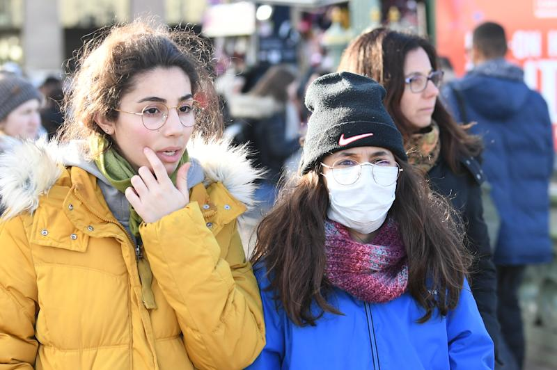 People wearing face masks on Westminster Bridge in London, as Shadow Health Secretary Jonathon Ashworth says he would support shutting down cities to control the spread of coronavirus. (Photo by Stefan Rousseau/PA Images via Getty Images)