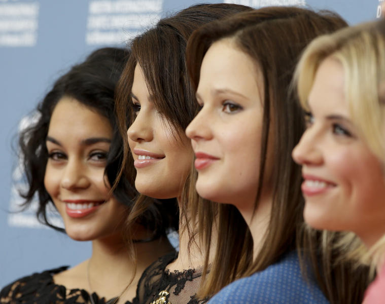 From left, actresses Vanessa Hudgens, Selena Gomez, Rachel Korine and Ashley Benson pose at the photo call for the film 'Spring Breakers' at the 69th edition of the Venice Film Festival in Venice, Italy, Wednesday, Sept. 5, 2012. (AP Photo/Andrew Medichini)