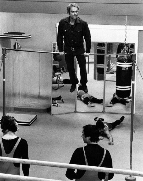 <p>From pull-ups to chin-ups—and whatever actor Terence Hill is demonstrating here—the bar was the easiest way to flex your strength at your gym. </p>