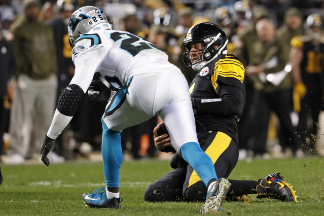 Pittsburgh Steelers quarterback Ben Roethlisberger begins his slide at the end of a run as Carolina Panthers strong safety Eric Reid (25) prepares to hit him during the second half of an NFL football game in Pittsburgh, Thursday, Nov. 8, 2018. Reid was ejected after the play. (AP Photo/Don Wright)