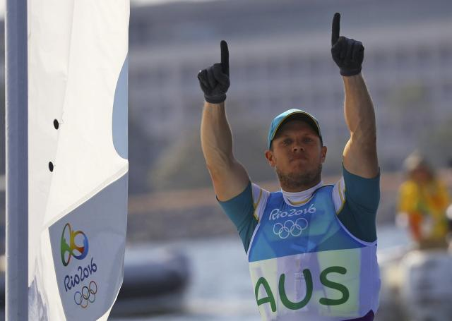 2016 Rio Olympics - Sailing - Final - Men's One Person Dinghy - Laser - Medal Race - Marina de Gloria - Rio de Janeiro, Brazil - 16/08/2016. Tom Burton (AUS) of Australia celebrates gold medal. REUTERS/Brian Snyder FOR EDITORIAL USE ONLY. NOT FOR SALE FOR MARKETING OR ADVERTISING CAMPAIGNS.