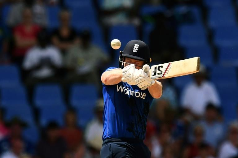 England's cricket team captain Eoin Morgan plays a shot during their One Day International match against West Indies in St. John's, Antigua, on March 3, 2017
