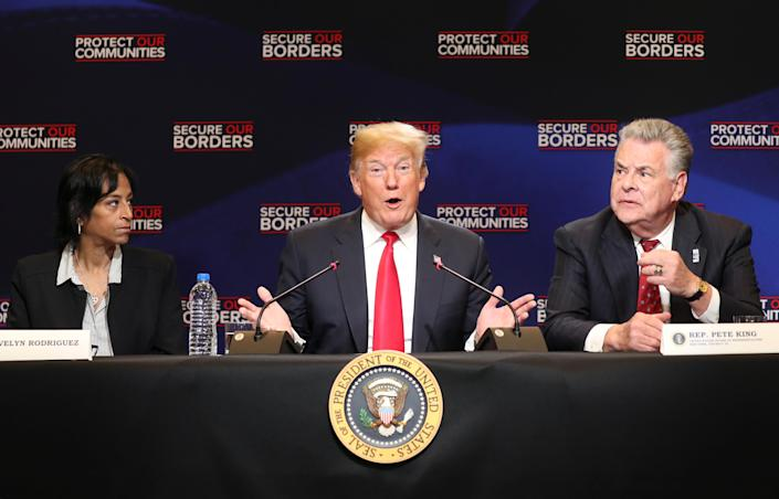 President Trump attended a roundtable on immigration in May 2018, sitting here between Evelyn Rodriguez, whose daughter was killed by MS-13 gang members, and U.S. Rep. Peter King, R-N.Y. (Photo: Kevin Lamarque/Reuters)